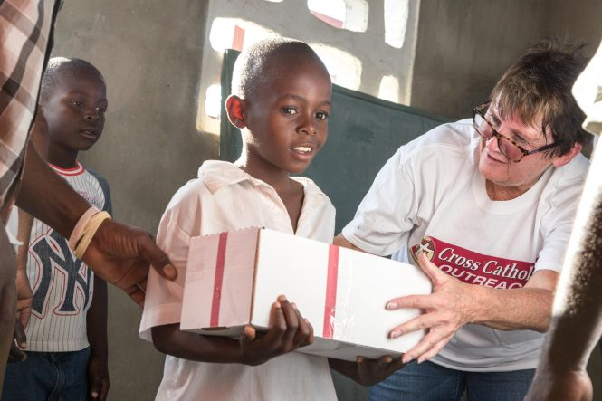 Box of Joy distribution at the St. Jean Baptiste, Christ the King Parish school in Haiti.