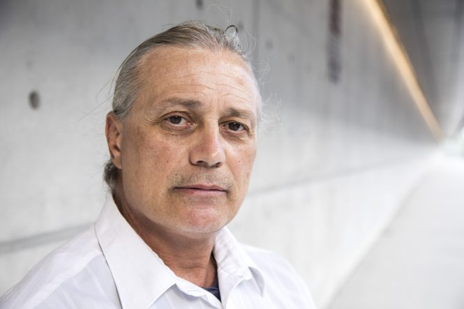 Investment-scam victim Mark Spanakos poses for a portrait in Ft. Lauderdale, Saturday, Feb 10.
