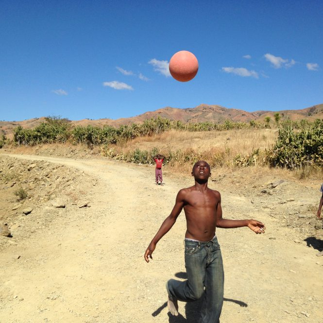 Boys play soccer in the road along the border of Haiti and the Dominican Republic.
