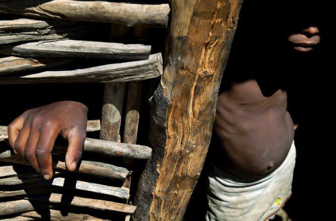 Languishing in the shadows of her poverty, Alexandra Visiosa, 7, of Haitian decent, lives in a stick shack on the Dominican Republic side of the border. Her grandmother says she and the other children can't attend school because they can't afford to get the required birth certificates.