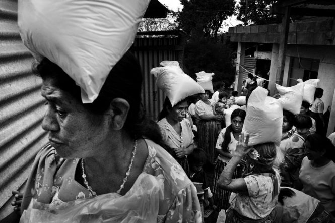 Guatemala Malnutrition - DistributionA relief agency distributes food to mothers in rural Guatemala. These women will carry the sacks home to their families and stretch the food for as long as many weeks as thy can, hoping that there will be more food to follow.