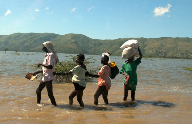 Water EverywhereResidents of Gonaives wade through more than a mile of floodwater in order leave the city. Tropical Storm Jeanne killed more than 2,000 in the area of Gonaives and left hundreds of thousands homeless, as it passed on Sept. 18, 2004.